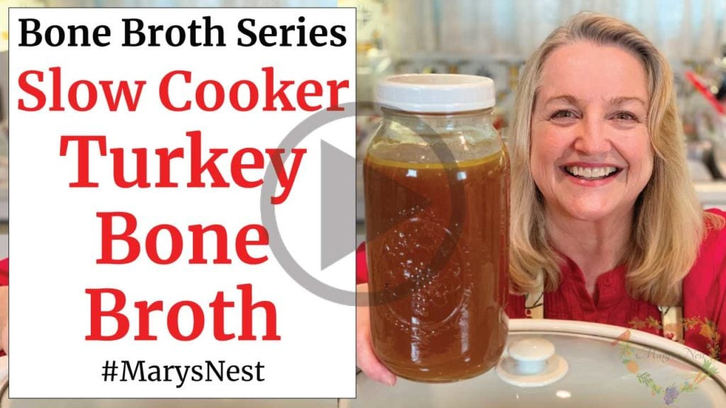 Mary holding a container of Turkey Bone Broth.