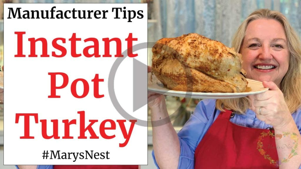 Mary holding a cooked turkey above an Instant Pot.